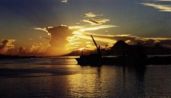 Sunset over Moorea from Cruise Ship at Papeete, Tahiti dock